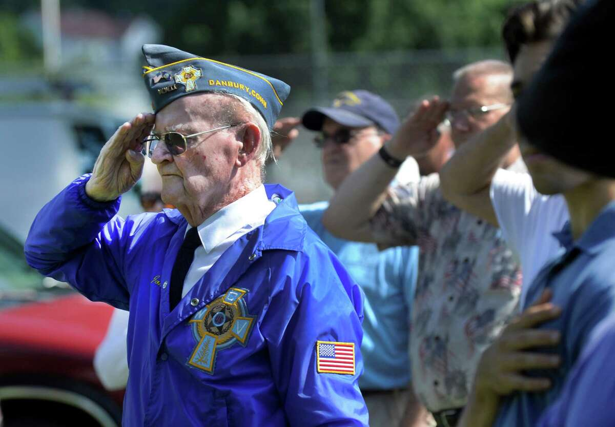 John Edmond, left, 90, of Danbury, who served on the U.S. Providence during World War II, participates in a ceremony at the Rogers Park Rose Garden marking the 71 st anniversary of the Japanese surrender and the end of World War II, Monday, August 15, 2016 in Danbury.