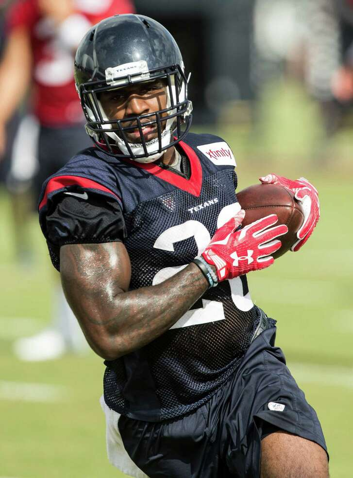 Houston Texans running back Lamar Miller (26) runs upfield after making a catch during Texans training camp at Houston Methodist Training Center on Sunday, July 31, 2016, in Houston. ( Brett Coomer / Houston Chronicle )