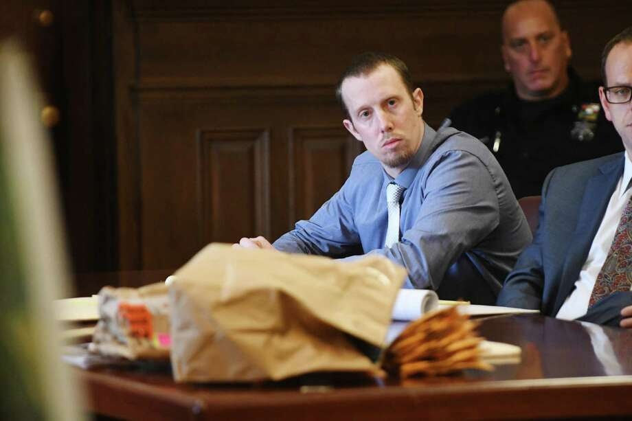 Jacob Heimroth, looks on as Rensselaer County Assistant District Attorney Andrew Botts addresses members of the jury as he delivers his closing statement in the double-homicide trial of Heimroth at Rensselaer County Court on Monday, August 15, 2016, in Troy, N.Y.    (Paul Buckowski / Times Union) Photo: PAUL BUCKOWSKI / 20037646A