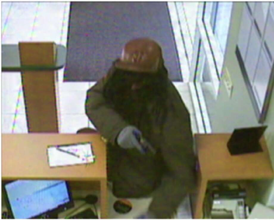 """The """"Dreaded Bandit"""" is seen on a security camera jumping the counter of a Bay Area bank. Photo: FBI / /"""