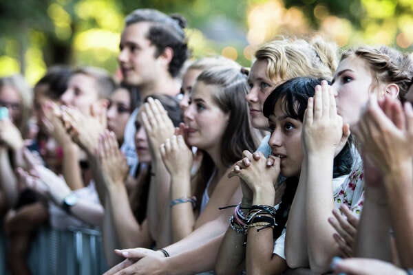 Festival goers clap along with The Dandy Warhols at the beginning of their set during the two-day Summer Camp music festival at Marymoor Park in Redmond on Saturday, Aug. 14, 2016. (Lacey Young, seattlepi.com)
