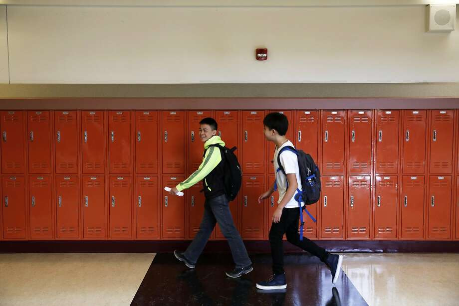 Two students walk to class on the first day of school at Martin Luther King Jr. Academic Middle School in San Francisco, California, on Monday, August 15, 2016. Photo: Connor Radnovich, The Chronicle