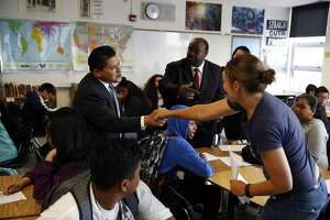 SFUSD Superintendent Richard Carranza (left) is introduced to 8th grade language arts teacher Jennifer Founds in a classroom at Martin Luther King Jr. Academic Middle School in San Francisco, California, on the first day of school Monday, August 15, 2016.