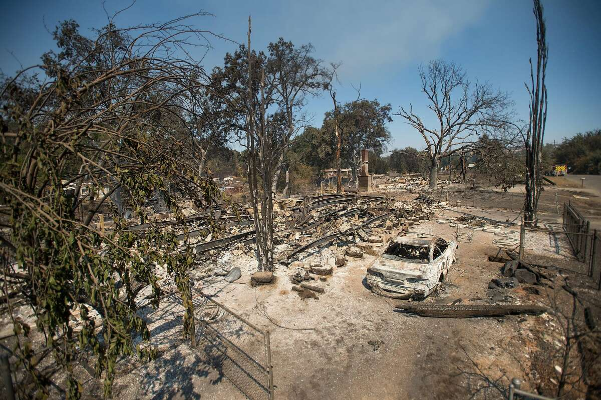 Burned residences and vehicles line a fire-ravaged neighborhood off Bonham Road after the Clayton Fire burned through Lower Lake, Calif., on Monday, Aug. 15, 2016.