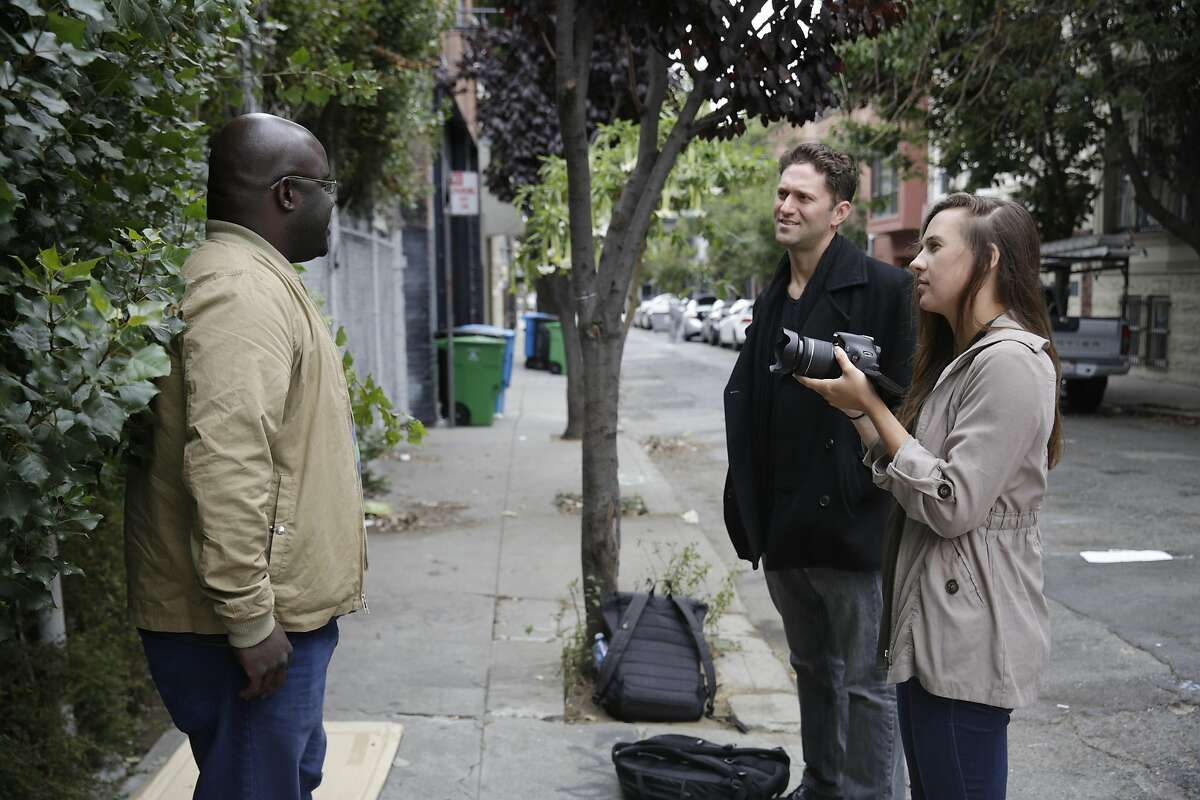 Kevin Adler (center), founder Miracle Messages, talks with Dennis Alexander (left) as Jessica Day (right), director of programs Miracle Messages, records video on a camera on Monday, August 15, 2016 in San Francisco, California. Alexander said he has been homeless since 2012 and recorded a message to reconnect with his grandmother.