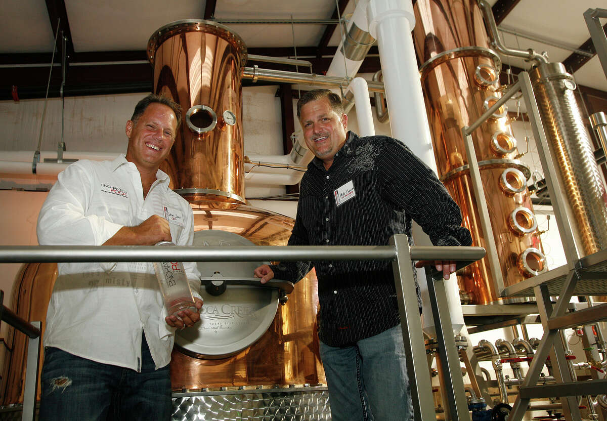 Rebecca Creek Distillery co-founders Steve Ison (left) and Mike Cameron are seen in this 2010 photo with the plant's custom built stills at a launch party for Enchanted Rock Vodka.