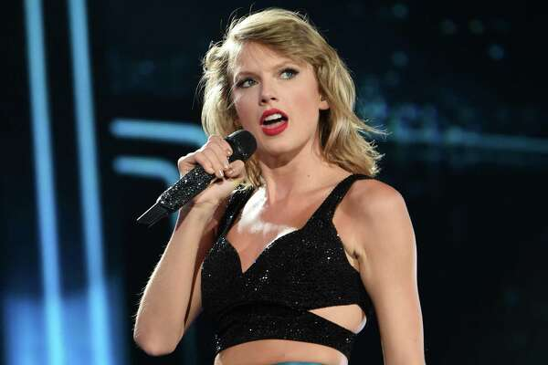 """FILE - In this July 10, 2015 file photo, singer Taylor Swift performs during her """"1989"""" world tour at MetLife Stadium in East Rutherford, N.J.  Swift leads the 2016 iHeartRadio Music Awards with eight nominations, followed by The Weeknd with seven nominations. The nominations were announced Tuesday, Feb. 9, 2016 by iHeartMedia and Turner. (Photo by Evan Agostini/Invision/AP, File)"""