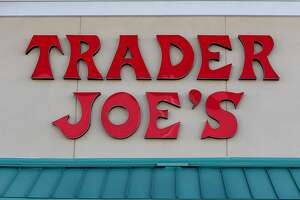 PINECREST, FL - OCTOBER 18: The Trader Joe's sign is seen during the grand opening of a Trader Joe's on October 18, 2013 in Pinecrest, Florida. Trader Joe's opened its first store in South Florida where shoppers can now take advantage of the California grocery chains low-cost wines and unique items not found in other stores. About 80 percent of what they sell is under the Trader Joe's private label. (Photo by Joe Raedle/Getty Images)