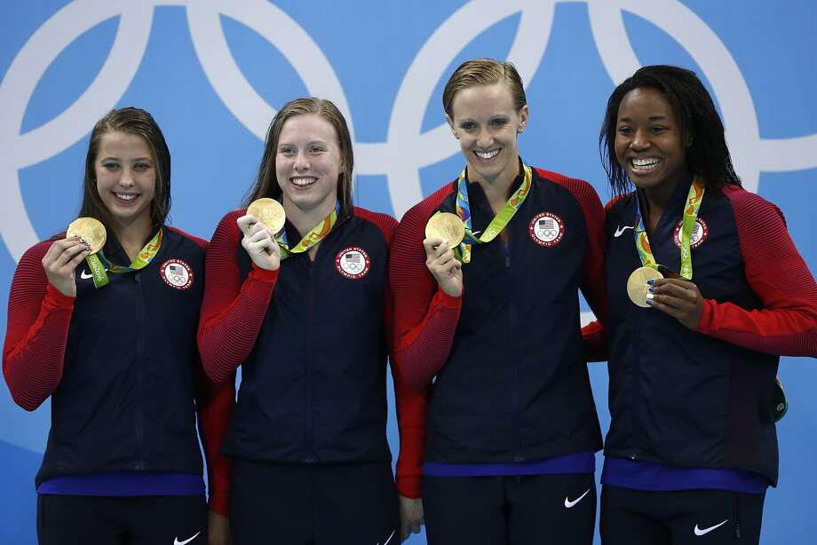 USA's team Kathleen Baker, Lilly King, Dana Vollmer, Simone Manuel pose during the podium ceremony of the Women's swimming 4 x 100m Medley Relay Final at the Rio 2016 Olympic Games at the Olympic Aquatics Stadium in Rio de Janeiro on August 13, 2016.   / AFP PHOTO / Odd ANDERSENODD ANDERSEN/AFP/Getty Images Photo: ODD ANDERSEN, AFP/Getty Images