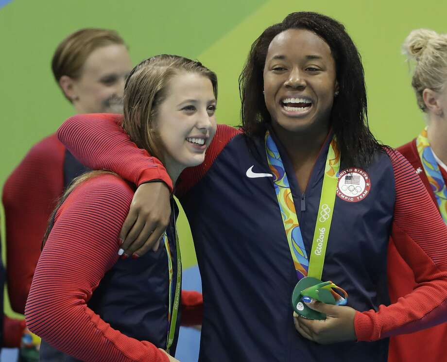 United States' Simone Manuel, right, embraces teammate Kathleen Baker after their team won gold in the men's 4 x 100-meter medley relay final during the swimming competitions at the 2016 Summer Olympics, Saturday, Aug. 13, 2016, in Rio de Janeiro, Brazil. (AP Photo/Rebecca Blackwell) Photo: Rebecca Blackwell, Associated Press