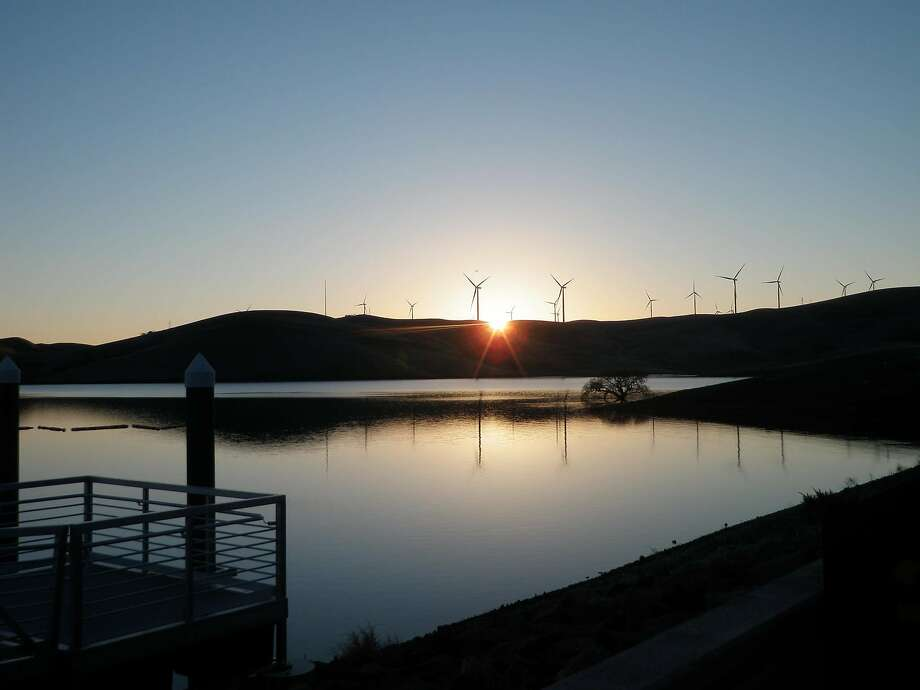 Dawn light over a still Los Vaqueros Reservoir, the windmills on the hillsides silhouettes. Los Vaqueros is located northeast of Livermore in remote Contra Costa County and is the Bay Area's largest recreation lake. Photo: Jim Freschi
