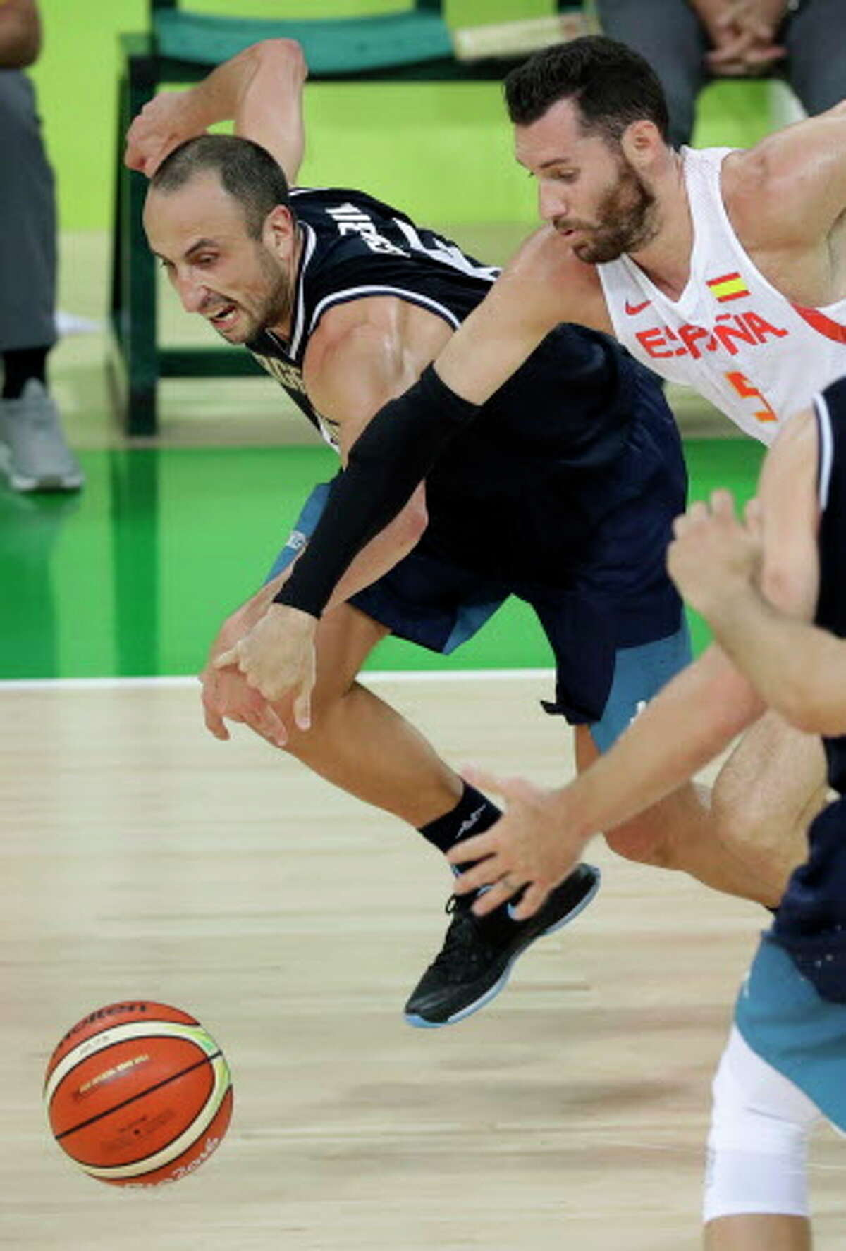 Argentina's Manu Ginobili, left, fights for a loose ball with Spain's Rudy Fernandez, right, during a basketball game at the 2016 Summer Olympics in Rio de Janeiro, Brazil, Monday, Aug. 15, 2016. (AP Photo/Charlie Neibergall)