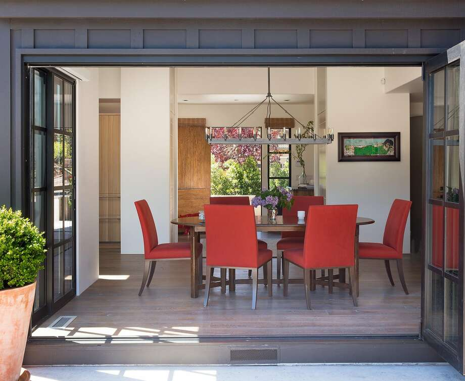 A set of poppy-hued Holly Hunt dining chairs were transplanted from the homeowners' previous Napa Valley residence. Photo: Justin Buell