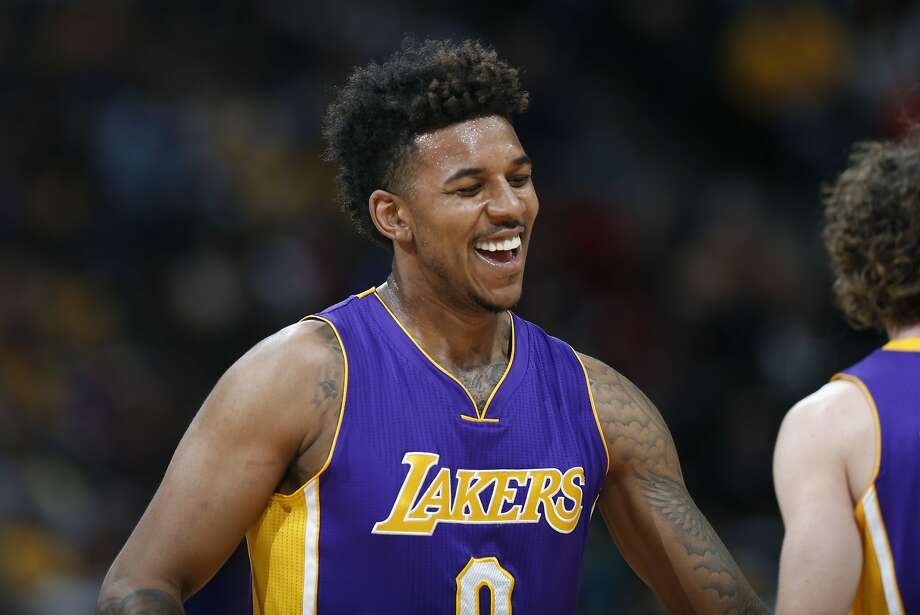 FILE - In this March 2, 2016, file photo, Los Angeles Lakers forward Nick Young smiles after hitting a 3-point basket against the Denver Nuggets during the second half of an NBA basketball game in Denver. A video posted by TMZ on July 5, 2016, shows Young holding a firework in his hand as it explodes. Photo: David Zalubowski, Associated Press