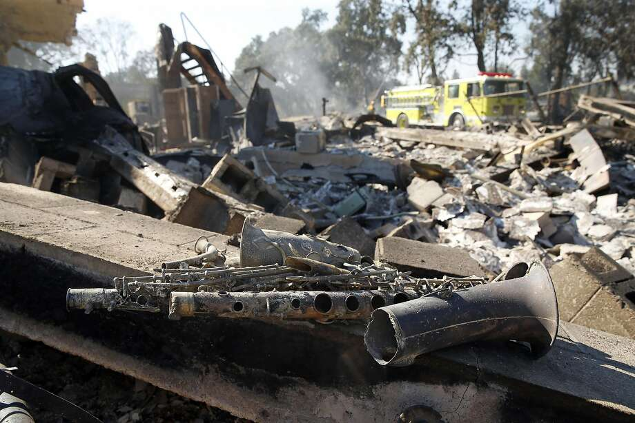 San Francisco Fire Department members do clean up near Mark Giberson's property that burned during Clayton Fire in Lower Lake, Calif., on Monday, August 15, 2016. Photo: Scott Strazzante, The Chronicle