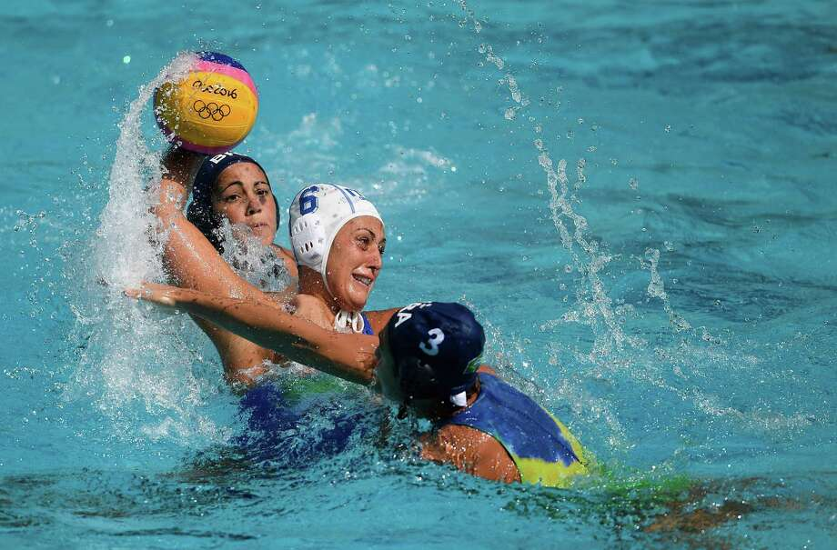 RIO DE JANEIRO, BRAZIL - AUGUST 09:  Maggie Steffens of USA shoots under pressure from Beatriz Ortiz Munoz and Anna Espar Llaquet of Spain during Water Polo Preliminary Round Group B match on Day 4 of the Rio 2016 Olympic Games at the Maria Lenk Aquatics Centre on August 9, 2016 in Rio de Janeiro, Brazil.  (Photo by Laurence Griffiths/Getty Images) Photo: Laurence Griffiths / Getty Images / 2016 Getty Images