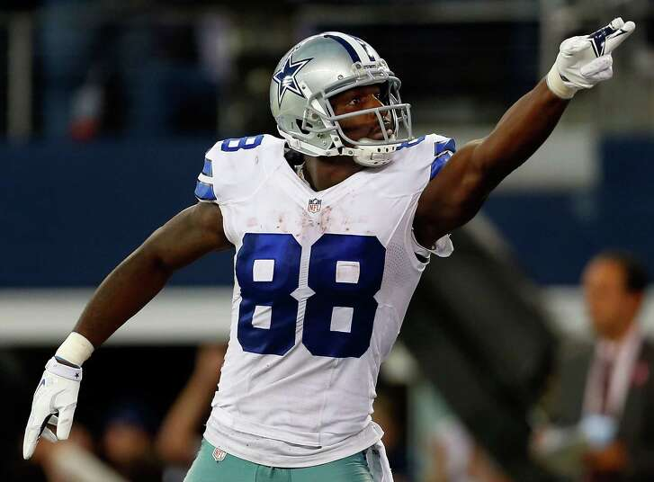 ARLINGTON, TX - OCTOBER 19:  Dez Bryant #88 of the Dallas Cowboys reacts after scoring a touchdown against the New York Giants in the second half at AT&T Stadium on October 19, 2014 in Arlington, Texas.  (Photo by Wesley Hitt/Getty Images)
