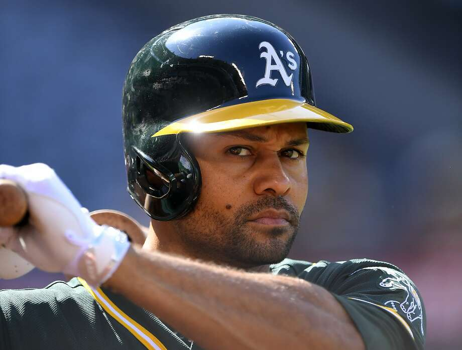 Coco Crisp says the A's aren't playing him to avoid having a $13 million vesting option for next season kick in. Photo: Mark J. Terrill, Associated Press