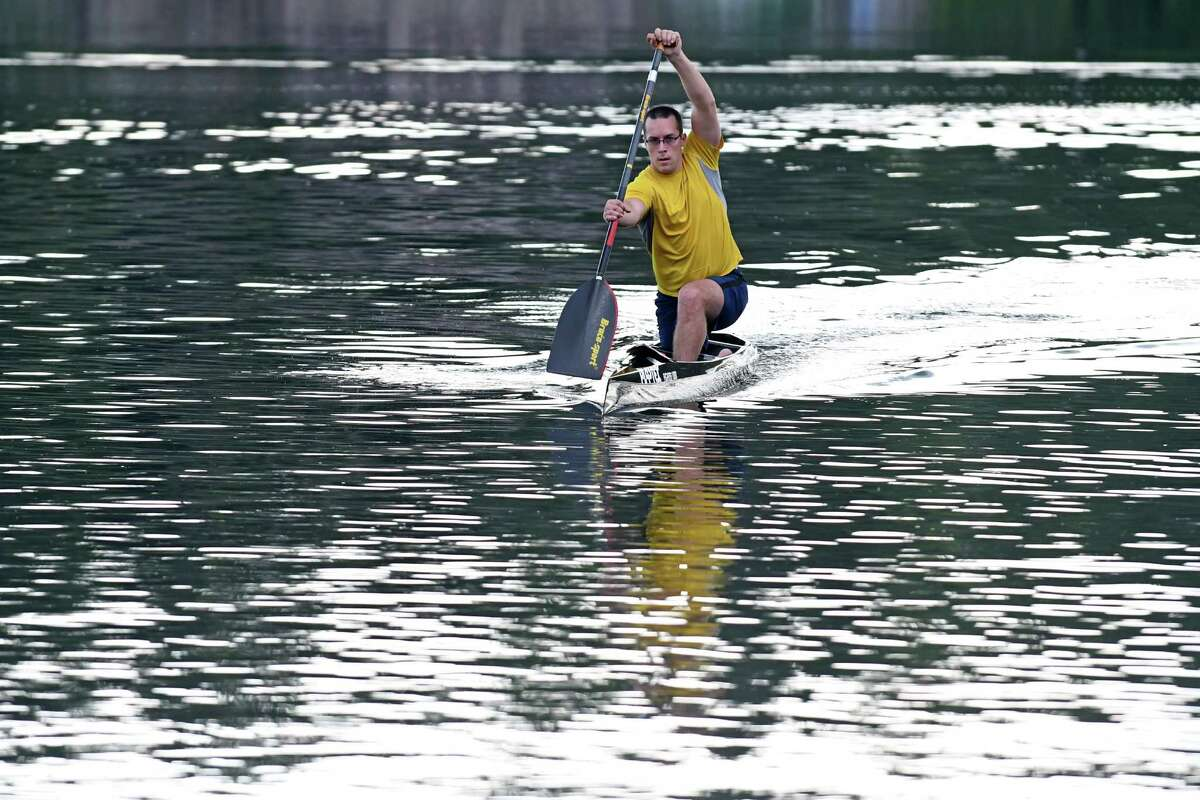 Justin Staubach kayaks on Warner's Lake on Wednesday Aug. 10, 2016 in East Berne, N.Y. (Michael P. Farrell/Times Union)