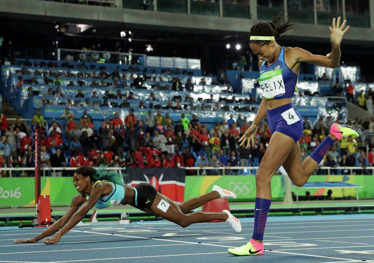 Shaunae Miller, left, of the Bahamas takes a painful route to Olympic glory by falling over the finish line to win the women's 400 meters and deny Allyson Felix of the U.S. a record-setting fifth gold medal.