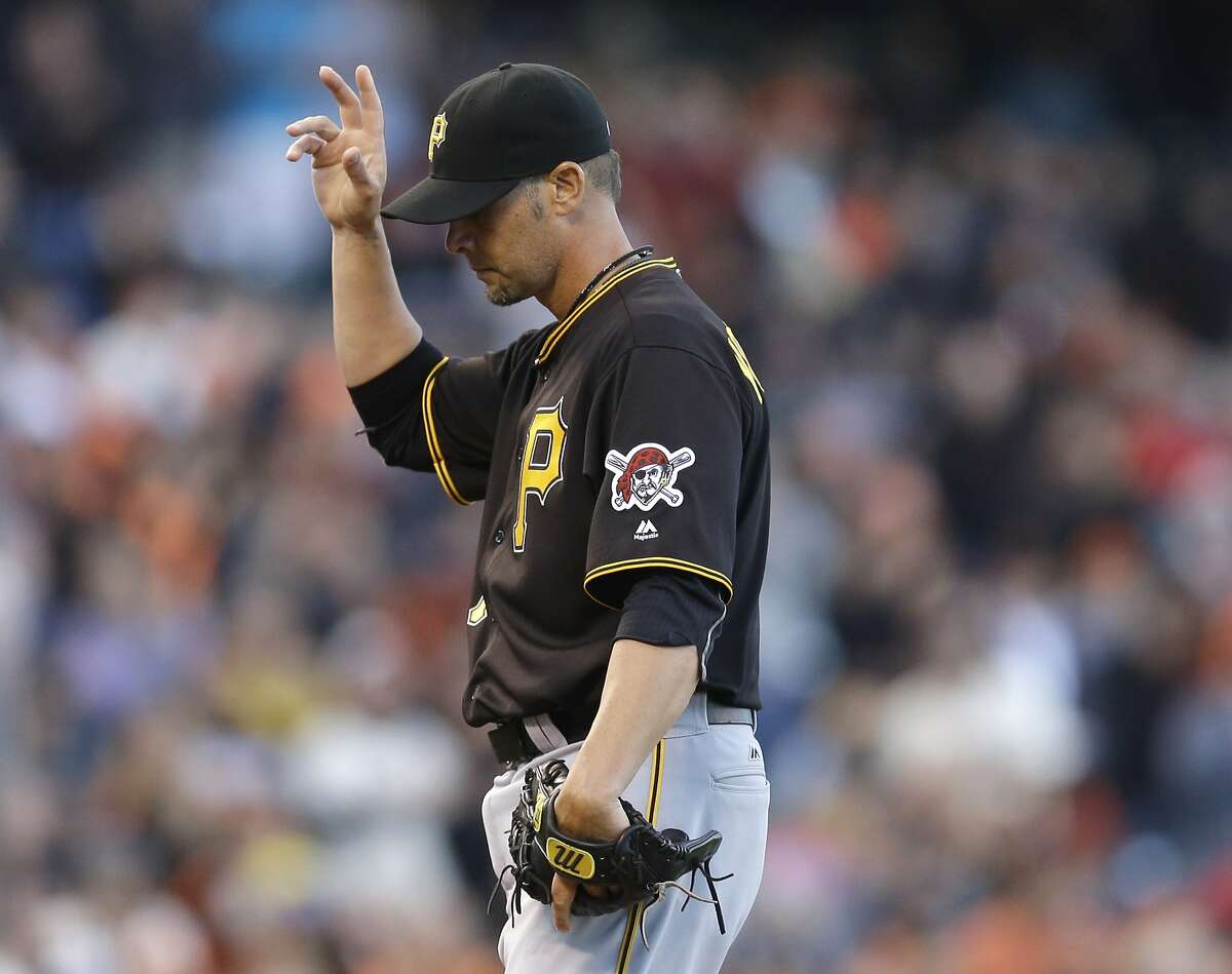 Pittsburgh Pirates pitcher Ryan Vogelsong acknowledges cheering fans before pitching against his former team, the San Francisco Giants, in the first inning of a baseball game Monday, Aug. 15, 2016, in San Francisco. (AP Photo/Ben Margot)