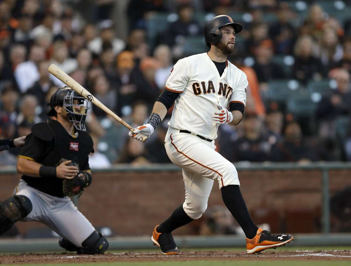San Francisco Giants' Brandon Belt swings for a base hit off Pittsburgh Pirates pitcher Ryan Vogelsong in the first inning of a baseball game Aug. 15 in San Francisco.