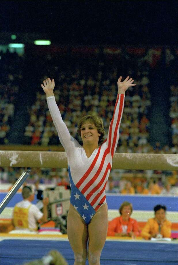 Mary Lou Retton reacts to applause after her performance at her Olympics gymnastic event on Aug. 3, 1984 in Los Angeles. She scored a total of 79.175 to take the gold medal in individual all around competition. (AP Photo/Suzanne Vlamis) Photo: SUZANNE VLAMIS, STF / 1984 AP