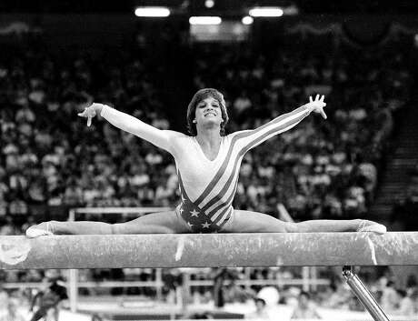 Mary Lou Retton celebrates her gold in the all-around at the 1984 Los Angeles Games.