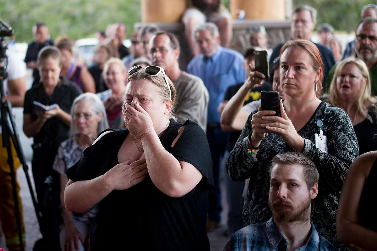 Michelle Waller reacts as fire officials announce the arrest of Damin Pashilk for 17 counts of arson during a community meeting in Middletown, Calif., on Monday, Aug. 15, 2016. Waller says she is waiting to hear if her Lower Lakes home survived the Clayton Fire.