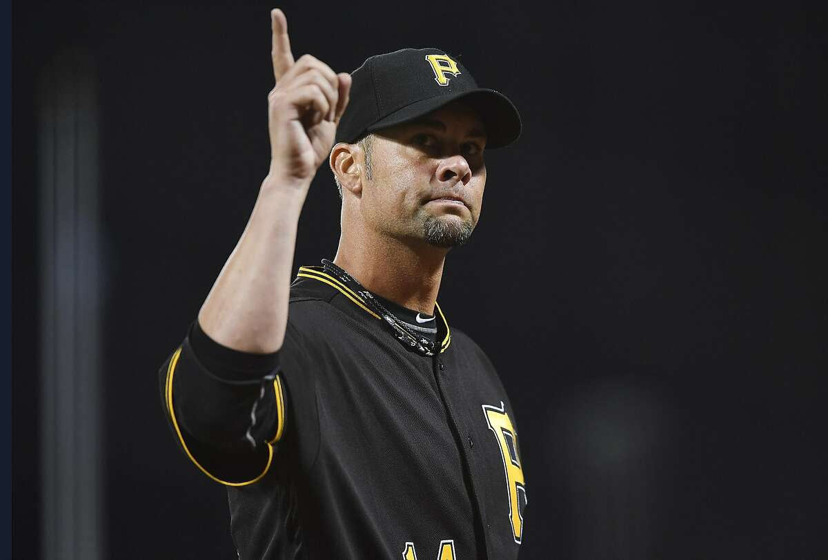 SAN FRANCISCO, CA - AUGUST 15: Ryan Vogelsong #14 of the Pittsburgh Pirates salutes the San Francisco Giants fans as he leaves the field after he was taken out of the game in the bottom of the six inning at AT&T Park on August 15, 2016 in San Francisco, California. Vogelsong played for the Giants from 2001-2001 and 2011-2015. (Photo by Thearon W. Henderson/Getty Images)