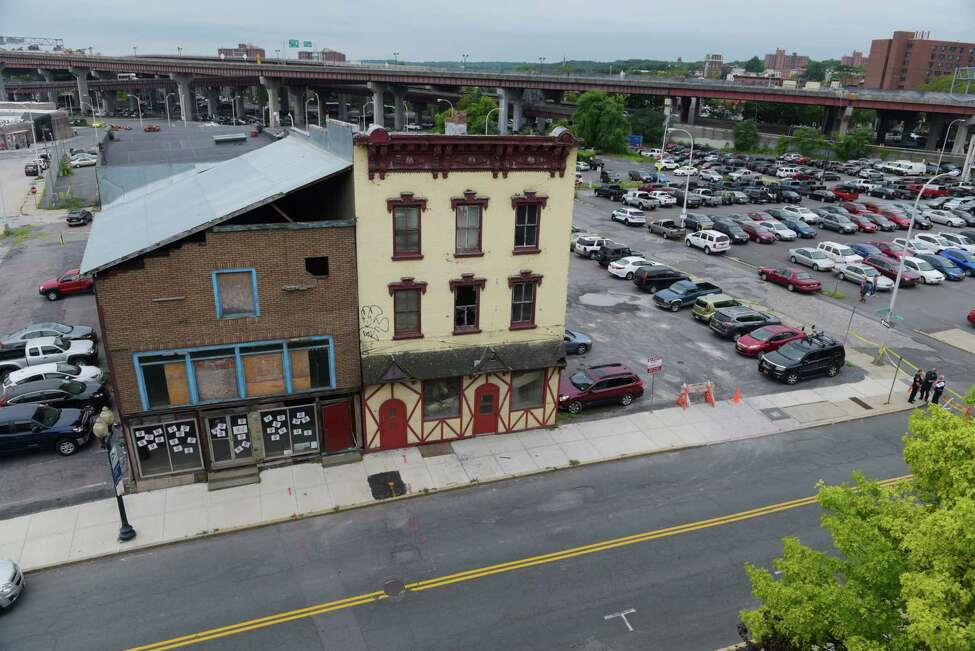 Buildings located at 48 and 50 Hudson Ave. on Tuesday, August 16, 2016, in Albany, N.Y. This section of Hudson Ave. has been closed because officials fear that 50 Hudson Ave., on right, is unstable. (Paul Buckowski / Times Union)