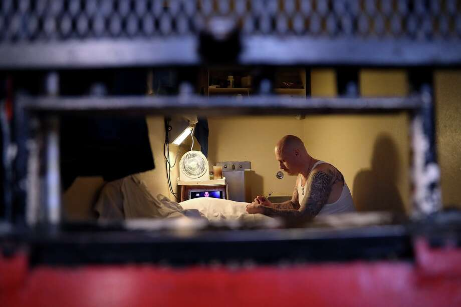 An inmate sits in his cell at San Quentin State Prison's death row on August 15, 2016 in San Quentin, California.  San Quentin State Prison opened in 1852 and is California's oldest penitentiary. The facility houses the state's only death row for men and currently has 700 condemned inmates.  (Photo by Justin Sullivan/Getty Images) Photo: Justin Sullivan/Getty Images