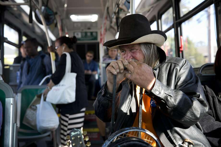 Sam Stone rides a bus to play mandolin at an open mic in Alameda on Wednesday, August 3, 2016. Stone has been homeless here on and off since 2007. Photo: Tim Hussin, The Chronicle