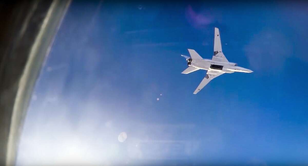 In this frame grab from video provided by Russian Defence Ministry press service, Russian long range bomber Tu-22M3 flies during an air strike over Aleppo region of Syria on Tuesday, Aug. 16, 2016. Russia's Defense Ministry said Tuesday Russian warplanes have taken off from a base in Iran to target Islamic State fighters in Syria. (Russian Defence Ministry Press Service photo via AP)