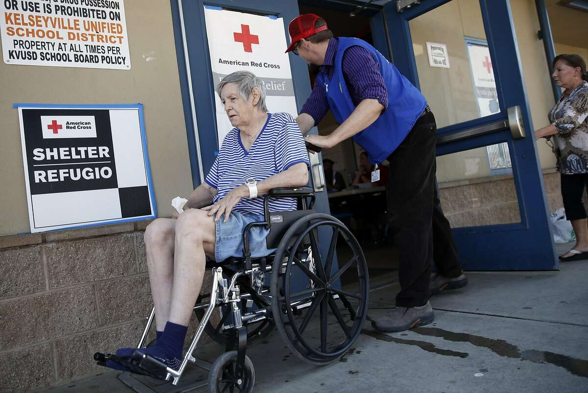 Joshua Sullivan helps Clayton Fire evacuee Irene
