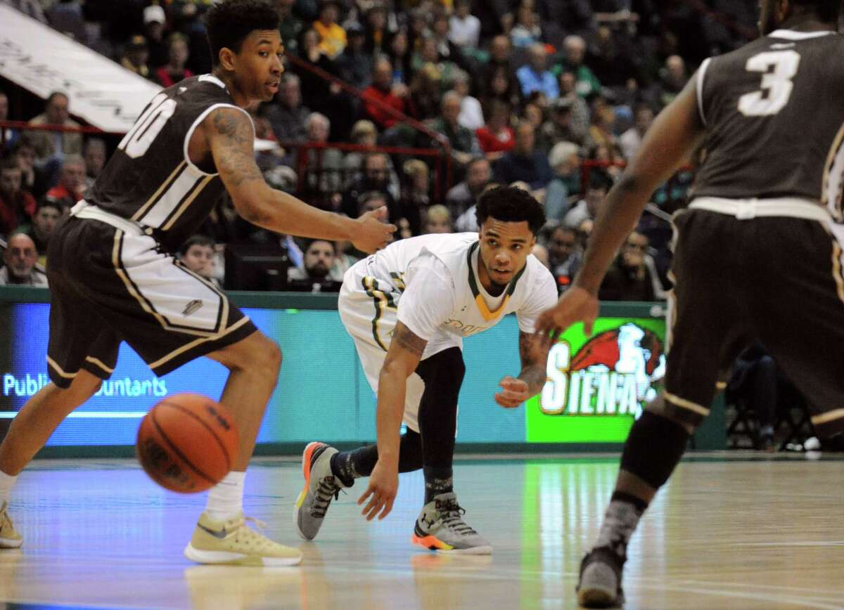 Siena's Kenny Wormley passes the ball during their men's college basketball game against St. Bonaventure at the Times Union Center on Tuesday Dec. 22, 2015 in Albany, N.Y. (Michael P. Farrell/Times Union)