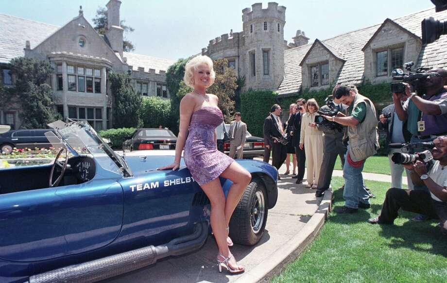 Playboy Magazine's Playmate of the Year for 1999, Heather Kozar, poses in front of the Playboy Mansion. Photo: David McNew/Getty Images