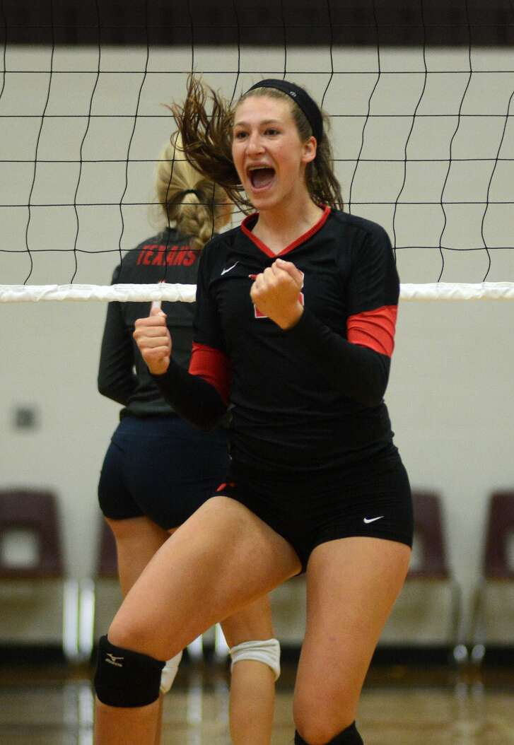 Memorial sophomore middle blocker Meredith Phillips celebrates a point during a Gold Bracket game at the 2015 Adidas Texas Volleyball Invitational at Pearland Dawson High School on Friday, August 14, 2015. (Photo by Jerry Baker/Freelance)