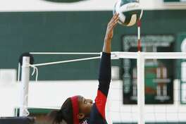 Sanaa' Dotson of Memorial goes for the kill as the Lady Mustangs took on Stratford in Match 1 of 2 at Stratford High School on August 25, 2015.