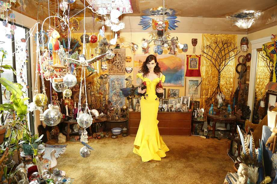 Lena Hall, with chickens, in one of the marvelously decorated rooms at Villa Satori, her family's Upper Haight home. Photo: Melisa Hall