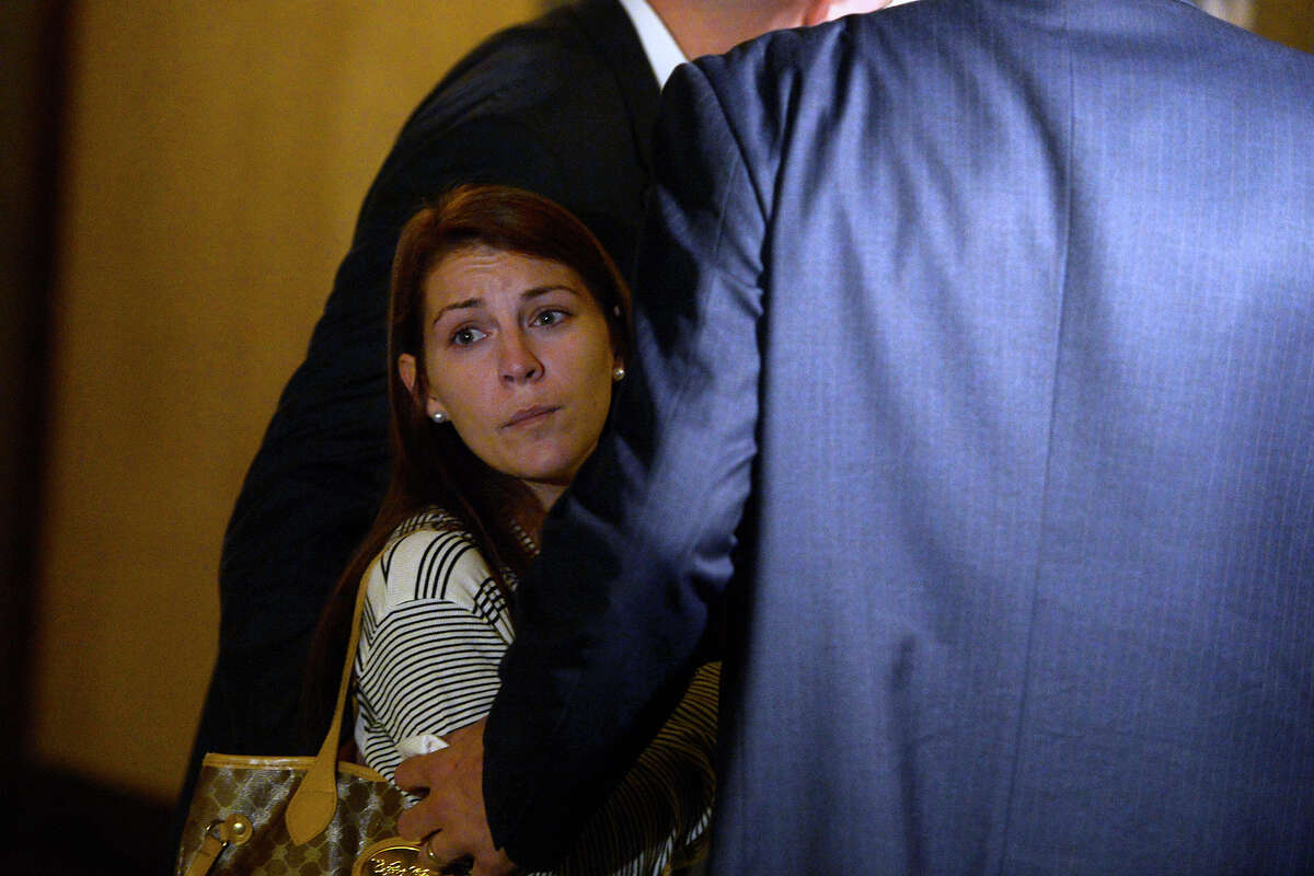 Rachel Melancon, mother of the late Olivia Coats, leaves the courtroom with her lawyers on Tuesday. A jury awarded Melancon $10,200,575 in the death of her newborn daughter. Photo taken Tuesday 8/16/16 Ryan Pelham/The Enterprise