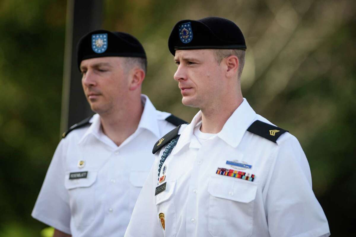 Sgt. Bowe Bergdahl, right, arrives with his military lawyer, Lt. Col. Franklin Rosenblatt, for a legal hearing at the courtroom facility on Thursday, July 7, 2016, on Fort Bragg, N.C. Bergdahl, who disappeared in Afghanistan in 2009 and was held by the Taliban for five years, is charged with desertion and misbehavior before the enemy. (Andrew Craft/The Fayetteville Observer via AP)