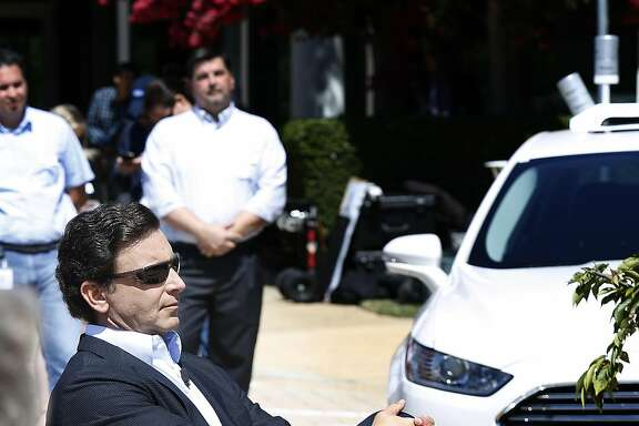 Ford's CEO, Mark Fields(middle with sunglasses), visits Ford's Silicon Valley research center to announce research on a self driving car planned for 2021 on Tuesday, August 16, 2016, in Palo Alto, Calif.
