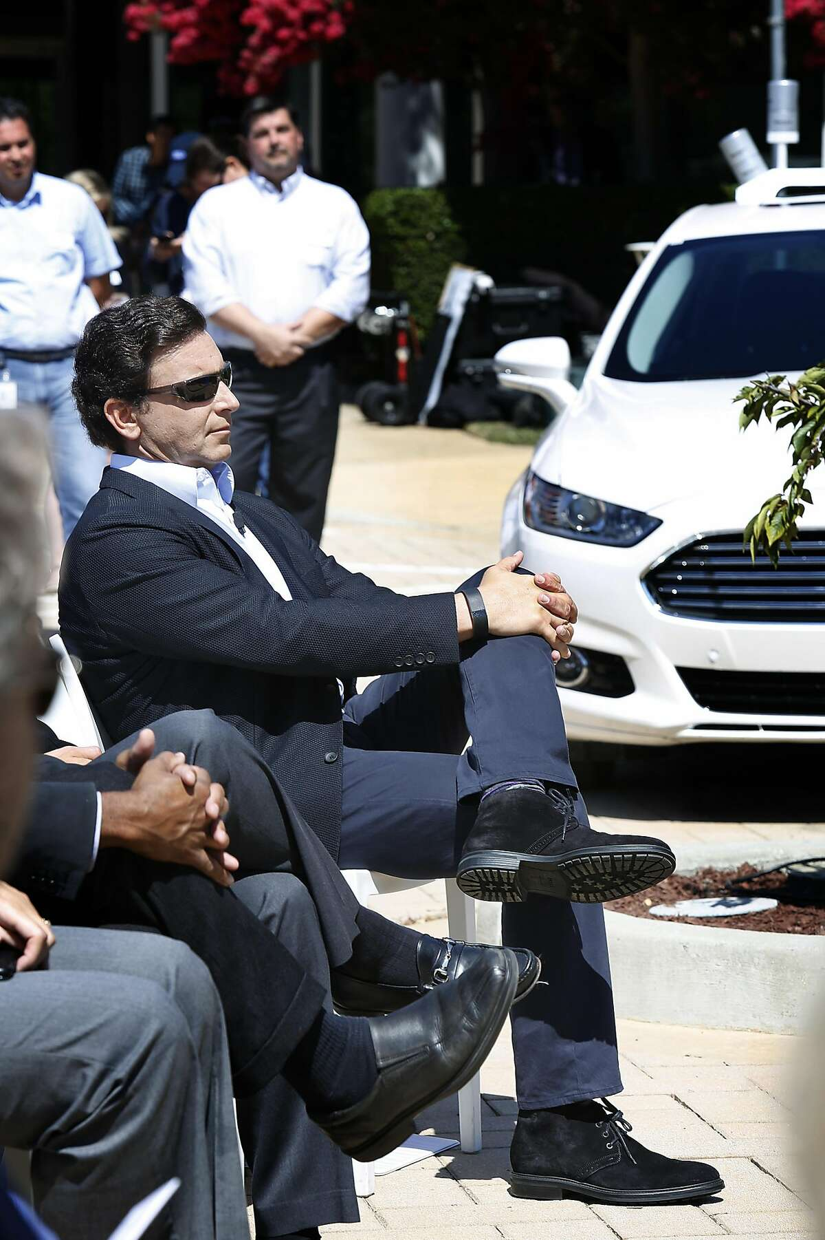 Ford CEO Mark Fields (middle with sunglasses) visits his company's research center in Palo Alto in August. As part of its development of driveless cars, Ford will invest $1 billion over five years in Argo AI, a Pittsburgh startup specializing in machine learning.