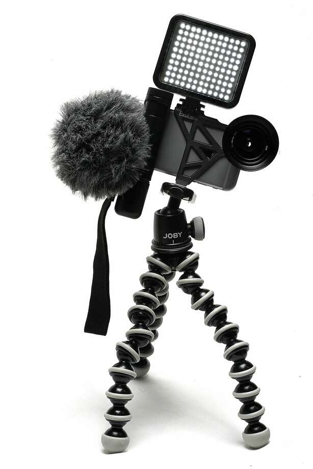 An iPhone is outfitted with photography- and videography-related accessories. Photo: Liz Hafalia, The Chronicle