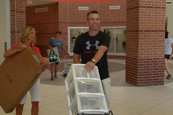 Mahaffey Elementary Principal Dayna Hernandez, left, helps physical education teacher David Short unload supplies during a staff orientation day earlier this month.  The $22 million campus opens Monday to Klein ISD pupils.Mahaffey Elementary Principal Dayna Hernandez, left, helps physical education teacher David Short unload supplies during a staff orientation day earlier this month.  The $22 million campus opens Monday to Klein ISD pupils.