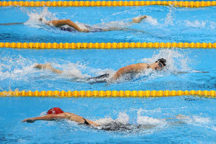 U.S. swimmer Katie Ledecky is so far ahead of the pack, they seem to be coming while she is going well into the women's 800m Freestyle, setting a world record of 8:04.79 and earning a gold medal at Olympic Aquatics Park in Rio de Janeiro, Brazil, on Friday, Aug. 12, 2016. (Robert Gauthier/Los Angeles Times/TNS) Photo: Robert Gauthier, TNS