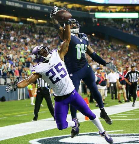 A final pass from Seahawks quarterback Trevone Boykin is just out of reach for wide receiver Antwan Goodley (14) who is defended in the endzone by Minnesota's Jabari, in the last seconds of their pre-season game at CenturyLink Field, Thursday, Aug. 18, 2016. Price (25) Photo: GENNA MARTIN, SEATTLEPI.COM / SEATTLEPI.COM