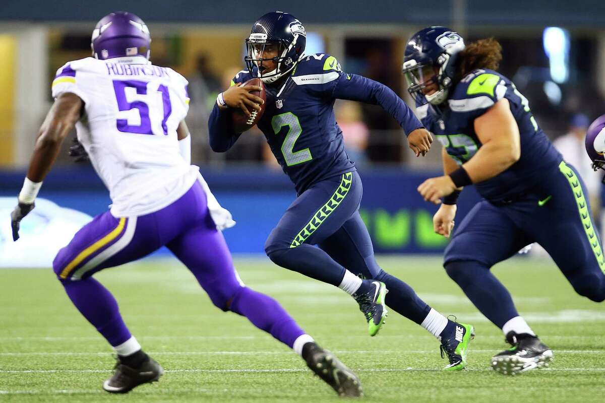 Seattle quarterback Trevone Boykin (2) runs the ball in the fourth quarter of the Seahawks vs. Vikings pre-season game at CenturyLink Field, Thursday, Aug. 18, 2016.