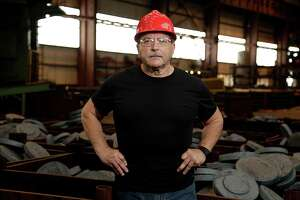 Boltex Manufacturing President Frank Bernobich poses for a portrait in front of bins of flange forgings at one of the company's manufacturing facilities Aug. 16, 2016, in Houston. ( James Nielsen / Houston Chronicle )
